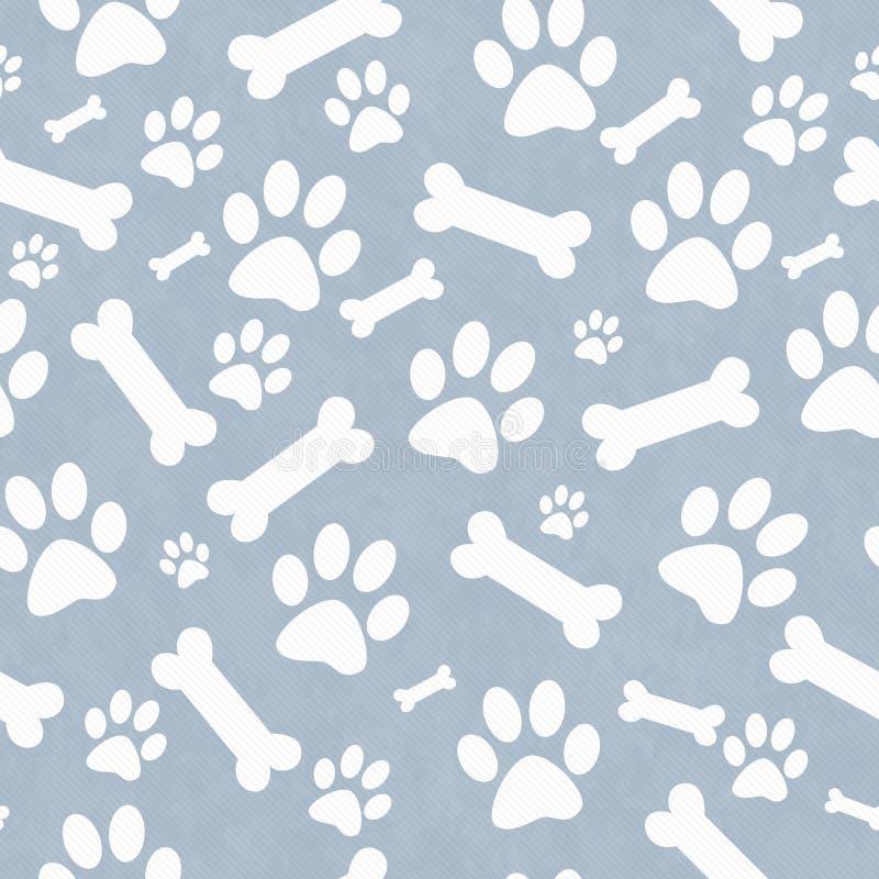 蓝色和白色狗爪子印刷品和骨头瓦片样式重复 库存照片