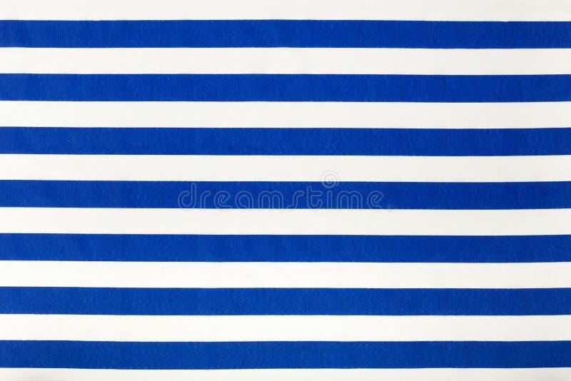 蓝色和白色镶边织品样式,背景 免版税库存图片
