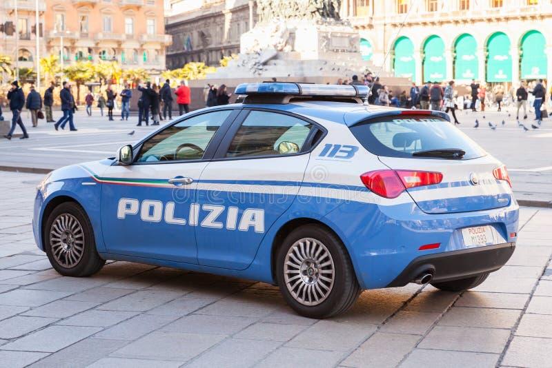 蓝色和白阿尔法・罗密欧Giulietta,警察 免版税库存照片
