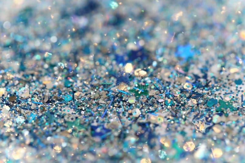 蓝色和银色结冰的雪冬天闪耀的星闪烁背景 假日,圣诞节,新年摘要纹理 库存图片