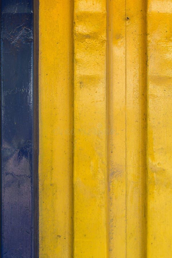 蓝色和黄色货船容器纹理 免版税库存照片