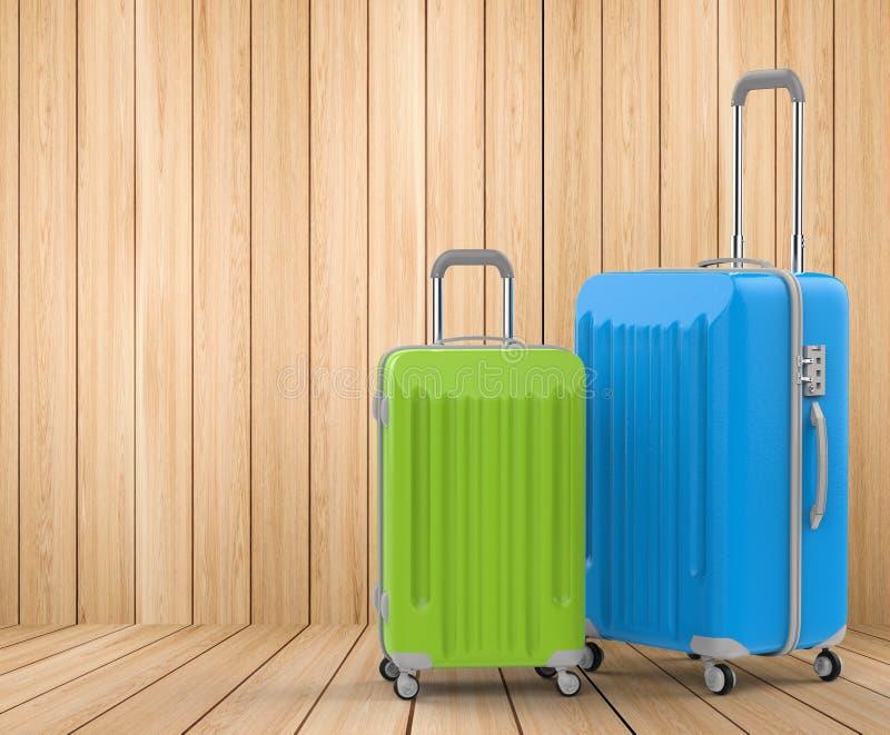 蓝色和绿色坚硬案件行李 免版税库存图片