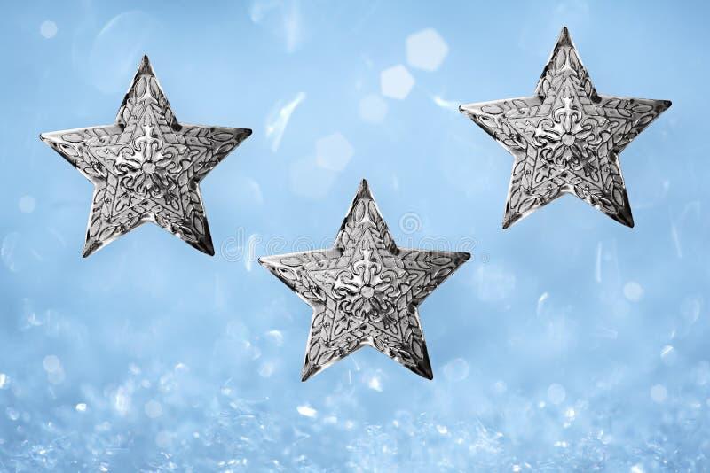 蓝色圣诞节金属饰件银色星形三 免版税库存图片