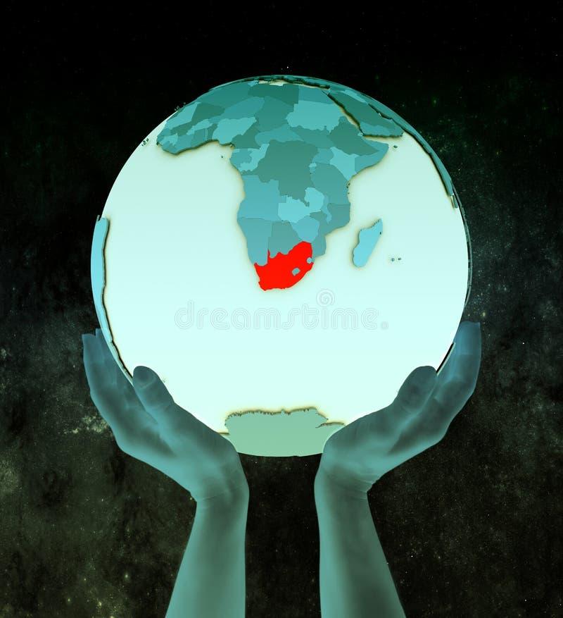 蓝色地球的南非在手上 库存例证