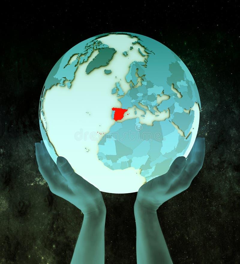 蓝色地球的西班牙在手上 皇族释放例证