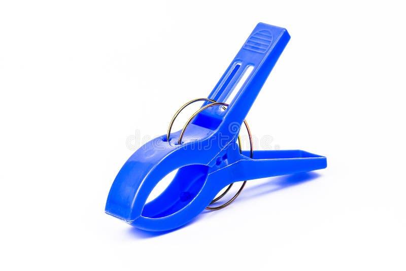 蓝色塑料夹子 免版税库存照片