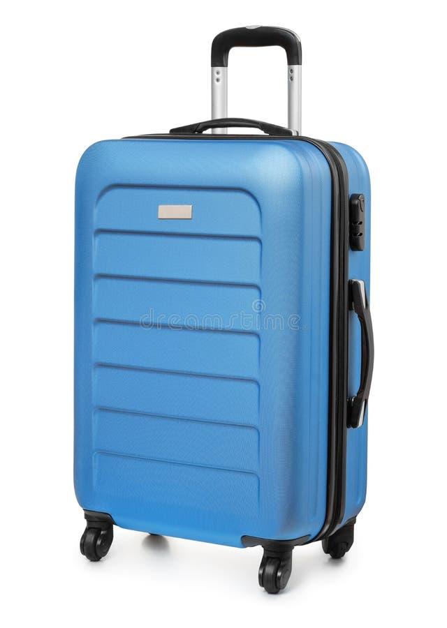 蓝色塑料手提箱 图库摄影