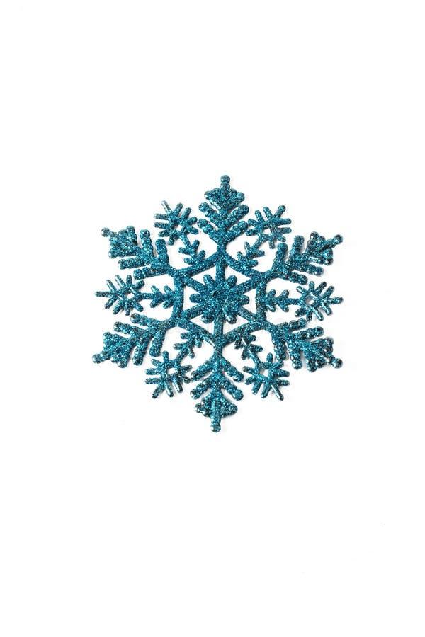 蓝色塑料雪花 库存照片