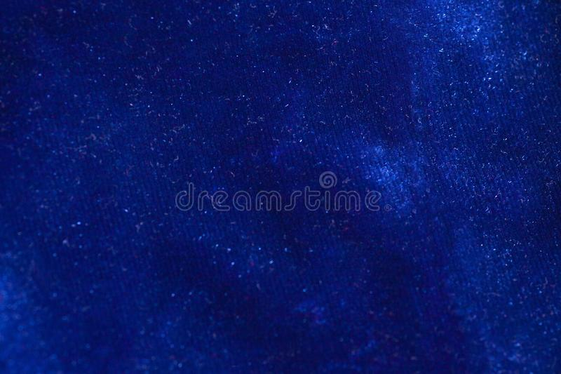蓝色天鹅绒织品背景纹理 免版税库存图片