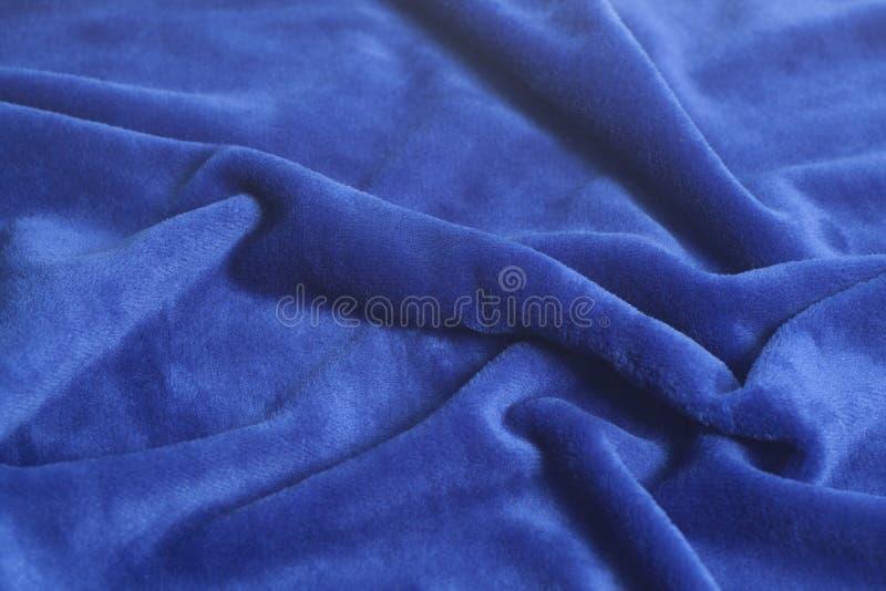 蓝色天鹅绒织品背景纹理 图库摄影