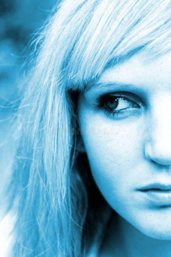 蓝色妇女年轻人 免版税图库摄影