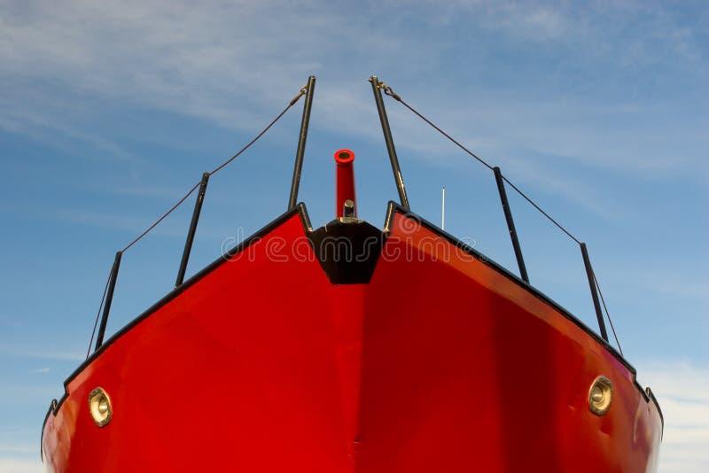 蓝色小船红色天空 免版税库存照片