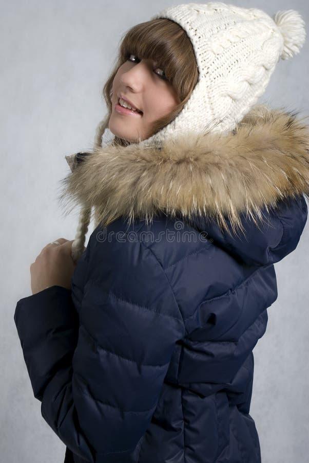 蓝色快乐的女孩夹克 库存照片