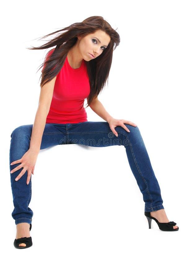 蓝色性感女孩愉快的牛仔裤 免版税库存照片