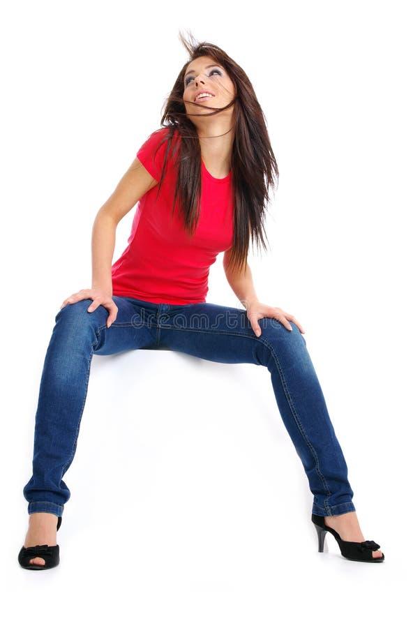 蓝色性感女孩愉快的牛仔裤 库存图片