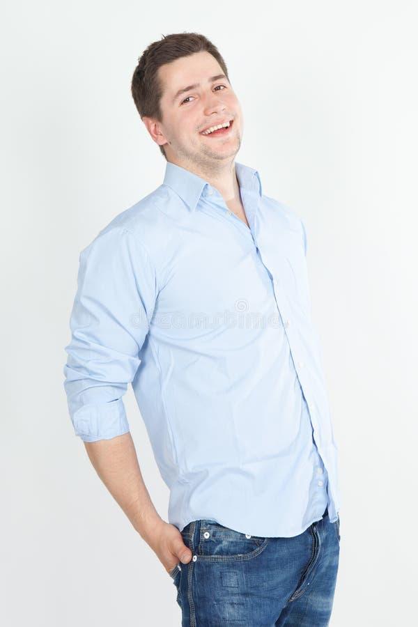 蓝色愉快的牛仔裤人衬衣年轻人 免版税库存照片