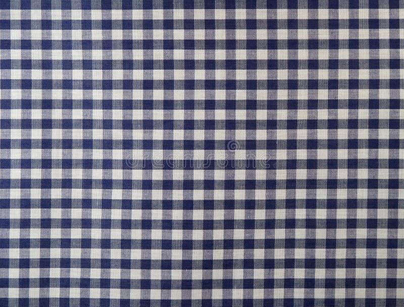 蓝色方格的黑暗的织品 免版税库存照片