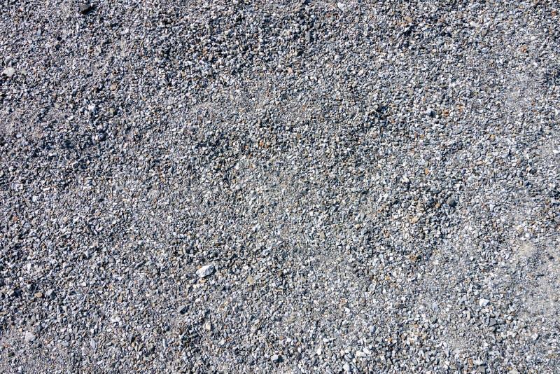 蓝色施工砾石纹理背景的顶视图 小花岗岩石全框背景 库存图片