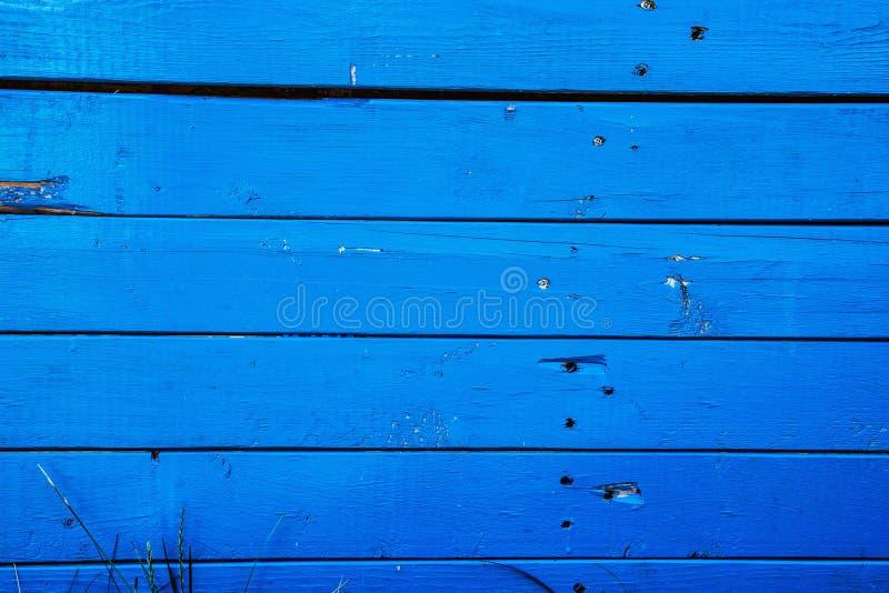 蓝色木墙壁背景,减速火箭的样式 库存图片