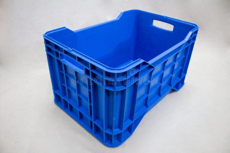 蓝色条板箱有白色背景 免版税库存照片