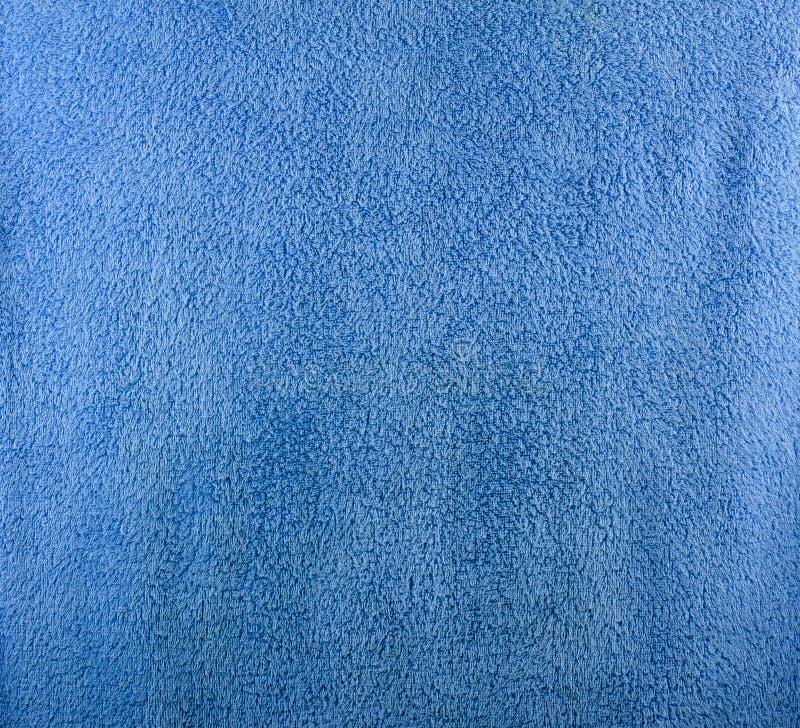 蓝色毛巾美好的纹理  免版税库存照片