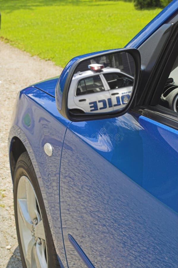 蓝色汽车镜子 免版税库存图片