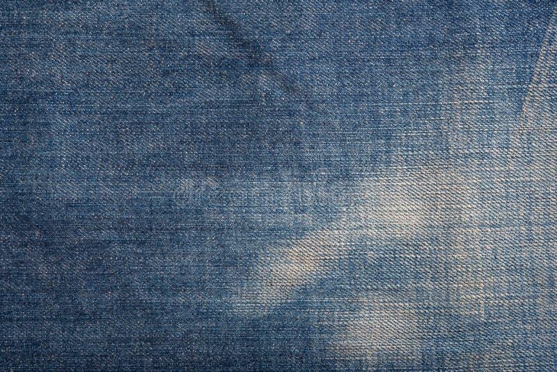 蓝色牛仔布斜纹布纹理和无缝的背景 图库摄影