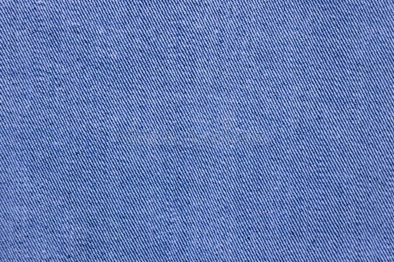 蓝色牛仔布织品,棉花牛仔裤纹理 免版税库存照片