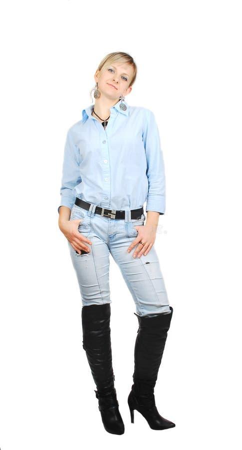 蓝色牛仔裤夫人 库存照片