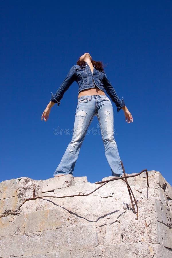 蓝色牛仔裤妇女 库存图片