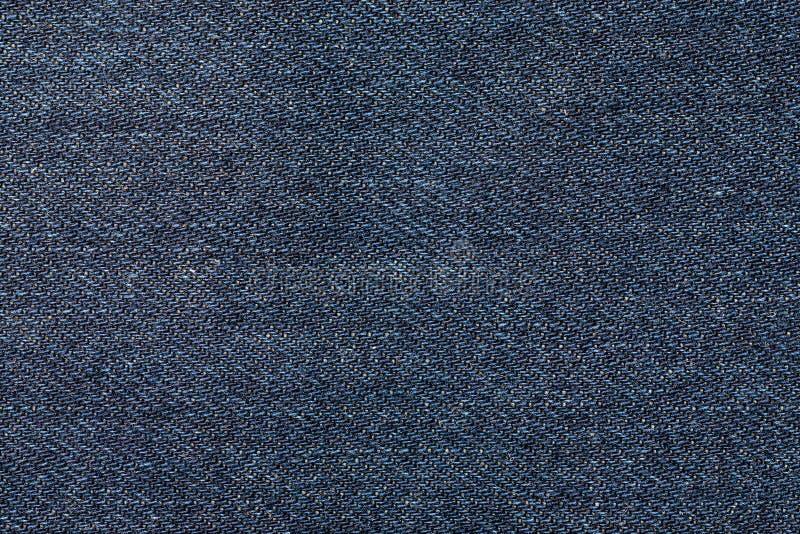 蓝色牛仔裤物质宏观射击,抽象纹理 免版税图库摄影