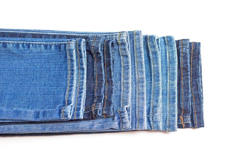 蓝色牛仔裤的底部 查出在白色 库存照片