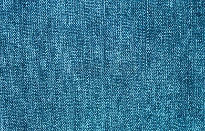 蓝色牛仔裤纹理或背景材料 免版税库存图片