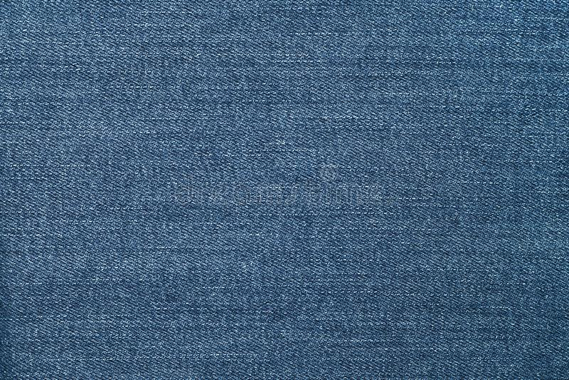 蓝色牛仔裤纹理 在蓝色牛仔裤背景的抽象样式 帆布牛仔布纹理 物质背景 黑暗的背景 Clothin 免版税库存照片