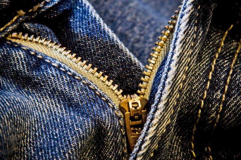蓝色牛仔裤解压缩的拉链 免版税库存图片