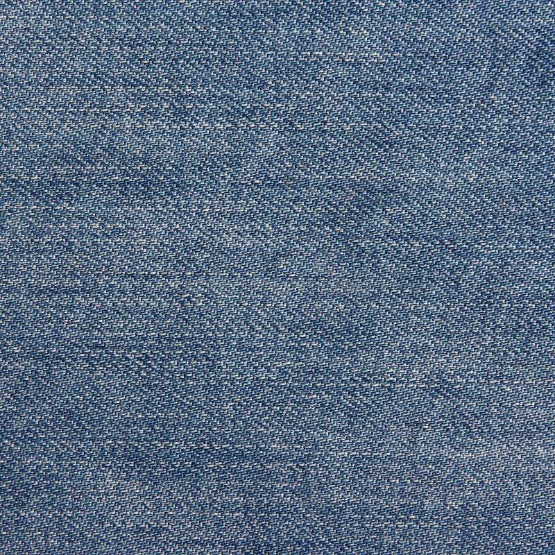 蓝色牛仔布牛仔裤纹理。 免版税库存图片