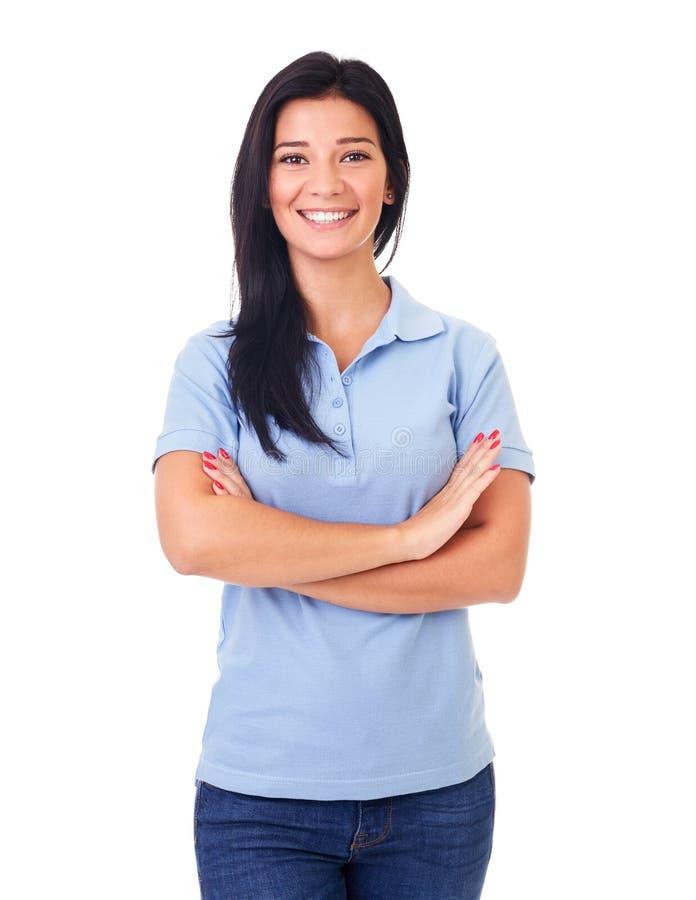 蓝色球衣的妇女有横渡的胳膊的 库存图片