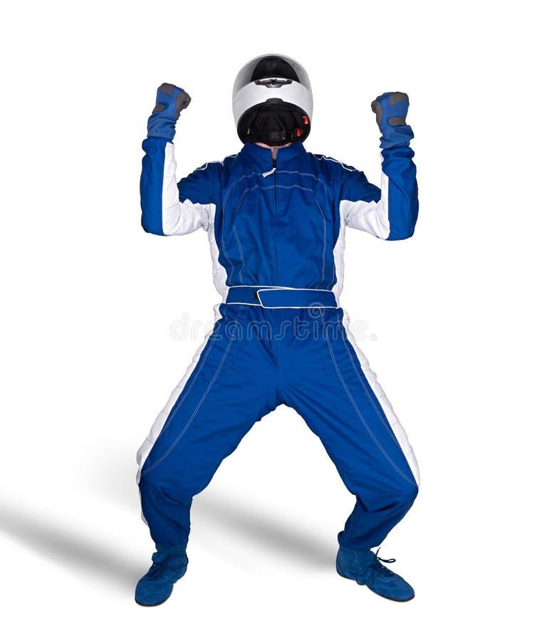 蓝色白色motorsport整体鞋子手套的庆祝在赢得的赛车手和安全齿轮安全帽被隔绝的白色以后 免版税库存照片