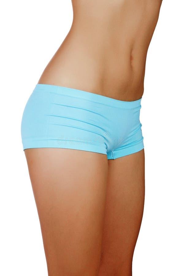 蓝色短内裤的适合的妇女 库存图片