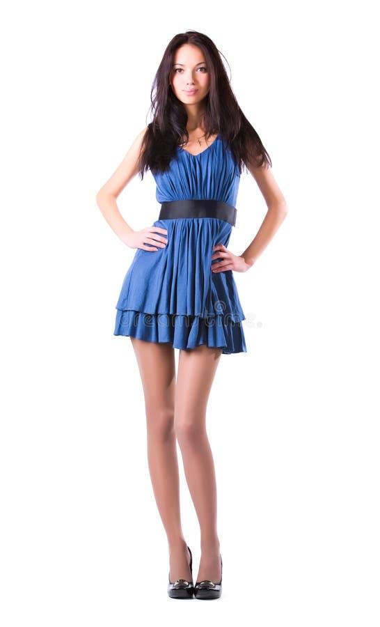 蓝色礼服亭亭玉立的妇女年轻人 免版税库存图片
