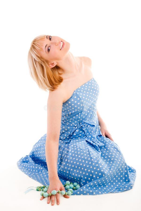 蓝色礼服女孩开会 免版税库存照片