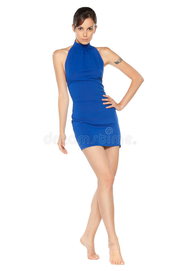 蓝色礼服女性摆在 免版税库存图片