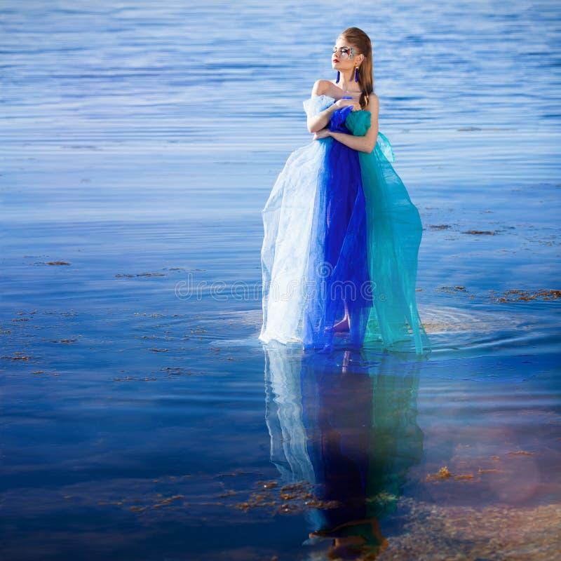 蓝色礼服幻想女孩 库存照片