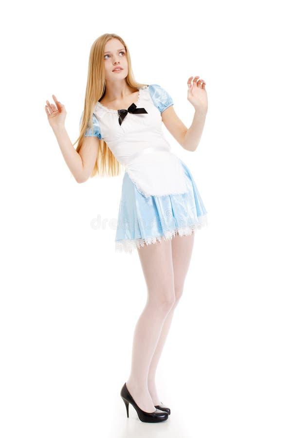 蓝色礼服的女孩有在白色背景的长的头发的 免版税库存照片