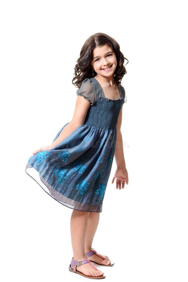 蓝色礼服的逗人喜爱的小女孩 图库摄影