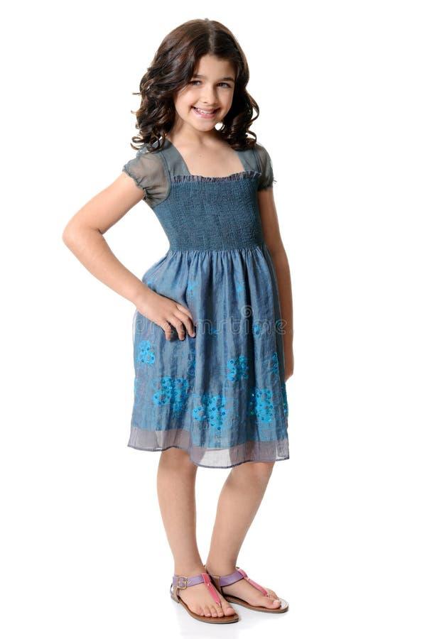 蓝色礼服的逗人喜爱的小女孩 库存图片