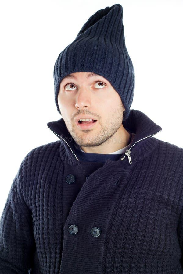 蓝色穿戴的英俊的人年轻人 免版税库存照片