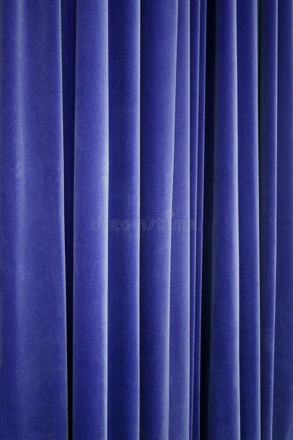 蓝色窗帘剧院天鹅绒 免版税图库摄影