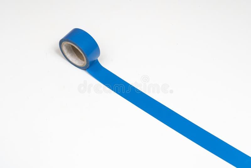 蓝色绝缘胶带卷 免版税库存照片
