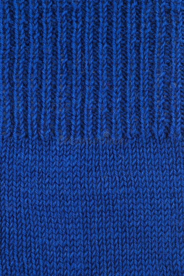 蓝色羊毛织地不很细背景 免版税图库摄影
